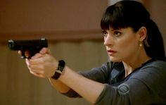 Paget Brewster wearing a watch inside of her wrist