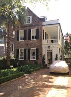 Charleston red brick house and white porch! Inspires me to make my new red brick house seem more southern and have more charm.