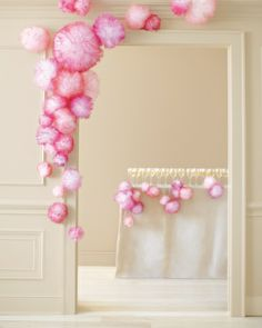 Festive pom-poms add cheer to any event space. Simply fashion inexpensive white tulle into different-size poufs, and mist with spray paint i...