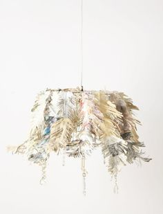 Add paper flowers to a stripped lampshade