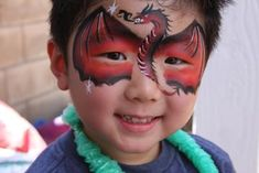 Dragon (Click on the smaller images to Enlarge) Tustin, California, USA  Color Me Face Painting-Face-painters in the Orange County.  We love transforming your guests into fearsome tigers, fiery dragons,