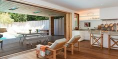 Pamela Anderson's Malibu Pad.  Another view of the home's open floor plan leading onto the deck.  Source: Chris Cortazzo
