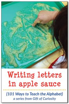 Writing letters in apple sauce. Combine letter learning with sensory play to help preschoolers learn the alphabet. I've gotta try this with my kids! || Gift of Curiosity