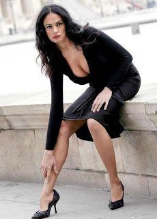 Maria Grazia Cucinotta in artistic classic city photo shoot session.