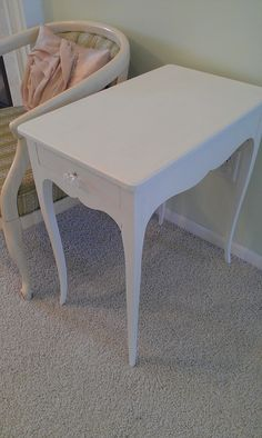 Thrifty Treasures: Sweet little end table- garage sale find redone by paint and a new knob.