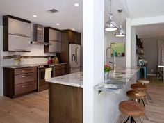 Room Transformations from the Property Brothers | HGTV A possibility in taking the wall out between kitchen and living room.