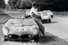 Wolfgang von Trips waits by his Ferrari Dino 246 SP after running out of petrol at the 1961 24 Hours of Le Mans.