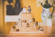 Sandcastle cake (as a wedding cake here but could replace the bride and groom on top for a flag for different events)