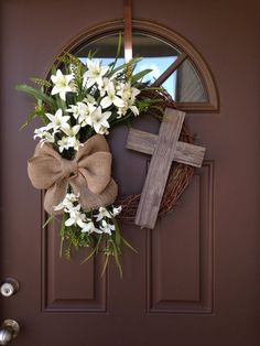 Beautiful Easter grapevine wreath with cream lilies,greenery and rustic burlap bow,accented with rustic cross and white veil over it. If you choose both white and purple veil ,only the purple veil will be on the cross,I will send you additional white veil that you can place on the cross on