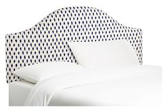 Navy and white ikat in the bedroom, swoon!
