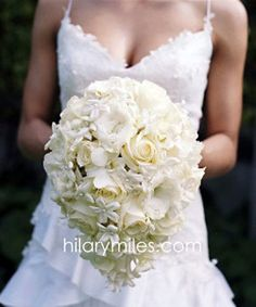 All white teardrop Bouquet of Roses, Orchids, Lisianthus, and Stephanotis blossoms with pearl insets. www.hilarymiles.com