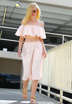 Summer vibes: Elle Fanning wore a baby pink crop top and matching skirt - October 7, 2015