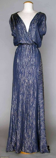 1930's Blue silk brocaded all over with silver lame in a palm frond motif, with suplice bodice. | Augusta Auctions