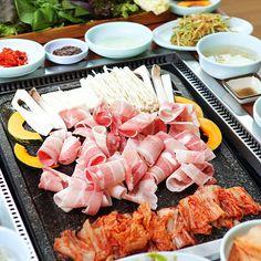 Samgyeopsal (Korean pork belly), grilled with kimchi and enoki mushrooms...yum!