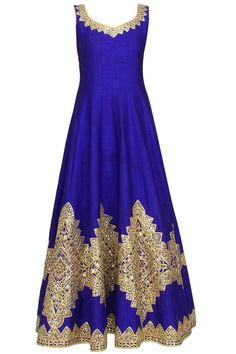 This blue anarkali is in raw silk fabric appliqued with diamond pattern gold gota patti lace and mirror work embroidery all over the front and bach ghera and ne