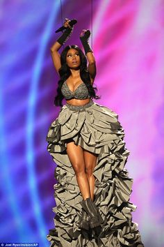 Wowing: Nicki looked angelic as she was lowered onto the stage, Twitter users said