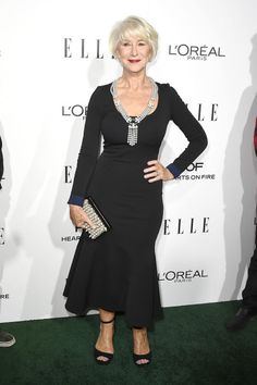 Helen Mirren accepts the Legend Award at ELLE's 23rd Annual Women in Hollywood Awards in a simply elegant Victoria Beckham dress.