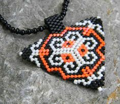 Triangle peyote pendant / necklace in orange black by Anabel27shop