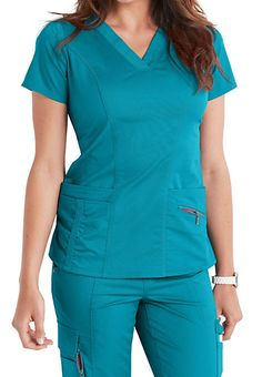 The Beyond Scrubs Ellie v-neck scrub top includes four pockets and plush stretch fabric. Shop for yours at Scrubs & Beyond. Scrub Tops, Princess Seam, V Neck Tops, Stretch Fabric, Favorite Color, Rompers, Fashion Beauty, Dresses For Work, Nursing Uniforms