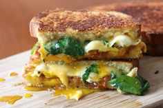 Sandwiched between two pieces of buttery crispy bread you will find sharp cheddar cheese, a runny egg, crispy bacon and spinach! Perfect for breakfast or brunch!