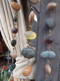 Rain chain using rocks and wire.  I LOVE this idea.
