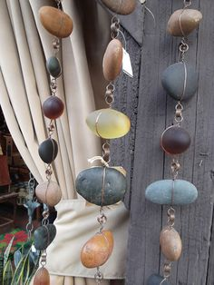 "Rain chain using rocks and wire. I bet it looks cool when it is raining. What a fun idea for those ""treasures"" you find on vacation or at the beach."