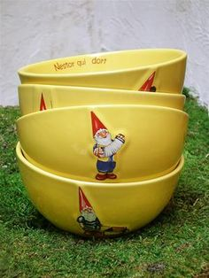 """Yellow French Gnome Bowls via Posh Chicago $15/each --- My favorite is """"Nestor Qui Dort""""! I have an *almost* complete set of these, with two of everything, including glasses and the different round bowl-like mugs. The brand behind the design is called Kiss That Frog, FYI! :)"""