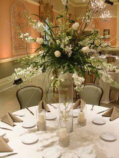 Tall all white centerpiece - orchids, stock, hydrangeas