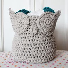 Owl basket, seen on missneriss.com.  Pattern for sale on Craftsy.