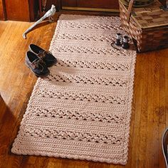 """<p><strong>Number of Designs:</strong> 2</p><p><strong>Approximate Design </p><p><strong>Size:</strong></strong> Scatter Rug 26"""" x 34""""; Runner 26"""" x 62""""</p><p><strong>Designer:</strong> Anne Halliday</p><p><strong>Original Publication:</strong> Leisure Arts Leaflet #2351, Rugs and Runners to CrochetSkill Level: Easy </p><p><strong>Description:</strong> The use of picot stitches creates a striking texture in this rug and runner pattern. Our instructions for these designs were written for a…"""