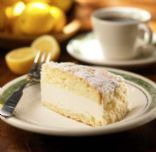 Olive Garden Lemon Creme Cake    1 white cake mix,prepared  8 oz. cream cheese, softened  2 cups powered sugar  1 cup heavy whipping cream, whipped to stiff peaks  3 tbsp. lemon juice  1/2 cup all purpose flour  1/2 cup powered sugar  1 tsp. vanilla extract  4 tbsp. butter