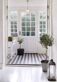 The floor is a little much, but if we're going to have an actual entry room, I'd like it to look something like this. Lots of windows/light and a clear sense of where you're supposed to go once you're inside.
