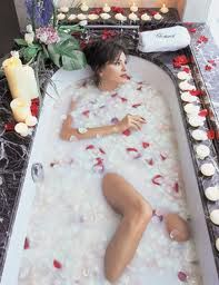 Goddess Bath  Ingredients:  1 can organic coconut milk,  1/4 rose petals,  3 tablespoons apricot oil,  6 drops rose essential oil  Directions:  Pour all ingredients (except for rose petals) into a blender for a few seconds to incorporate. Pour mixture into running bath water. Sprinkle rose petals in bath. Ooohh la-la…. :)
