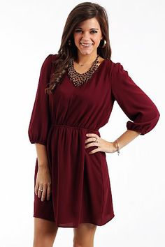 """Back To You Dress, Burgundy $44.50  This dress does not disappoint! The beautiful burgundy a-line dress has three-quarter length sleeves and is gathered in all of the right places to give the perfect flattering fit! We love the V cutout in the back that shows a black lace panel!!   Fits true to size. Miranda is wearing a small.   From shoulder to hem:  Small - 33.5""""  Medium - 34""""  Large - 34.5"""""""