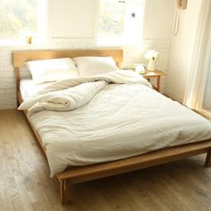 full sized bed with white bedsheets