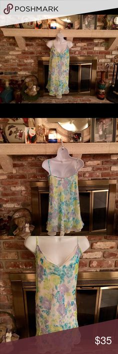 Vintage Gilligan and O'Malley floral nightie Vintage Gilligan and O'Malley floral baby down the lady lined floral lavender blue baby blue lime green green lavender purple shades beautiful baby doll in excellent condition 💯% polyester.             RN 17730 XXL Gilligan and O'Malley Intimates & Sleepwear Pajamas