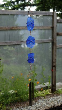 A beautiful glass and copper sun catcher wind chime with brass chimes. The 3 artist-made copper wrapped beach glass pieces are smooth with a mat finish. This sun catcher chime measures 28 inches from