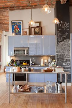great ideas for a small kitchen... I wonder if I knocked down a wall if I could pull this off in my teeny kitchen- I LOVE it and HAVE the high vaulted ceiling!