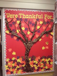 Thanksgiving bulletin board. Twist butcher paper to make tree trunk and branches. Have students write something they are thankful for on leaves. Easy!
