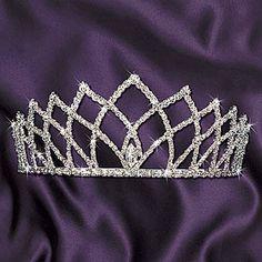 The Grand Coronation Tiara has a striking design of silver rhinestones. Each Grand Coronation Tiara is made of metal measuring 2 5/8 inches high.