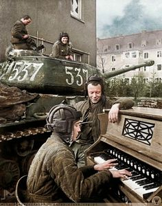 Soviet tanker plays an organ during World War 2 1940s (Colorized)