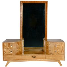 Fabulous Frankl Ceruse Vanity and Mirror  USA  1940s  A delicious and glamorous Paul Frankl vanity in ceruse oak with brass details. A chic addition to any diva's boudoir.