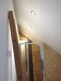 Loft conversion master bedroom en-suite.  Travertine mix.  Glass mosaic in show area #sdbtilingltd