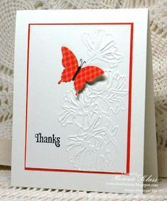 Die Cut Butterfly on patterned paper over embossing folder card.