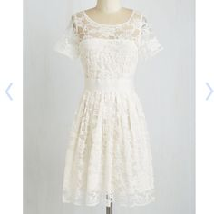 Adrift on a Cloud Dress in Ivory ModCloth exclusive fully lined ivory BB Dakota dress with a floral pattern lace overlay. Lace is 62% cotton, 38% nylon. Lining is 100% cotton. Fabric does not provide stretch. Back zipper with hook and eye closure. Brand new with tags. ModCloth Dresses