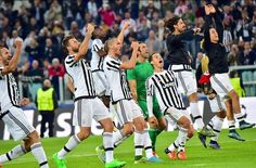 Juventus players celebrate at the end of the game.