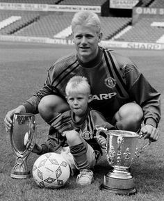 Peter and Kasper Schmeichel with the League Cup and UEFA Super Cup at Old Trafford, 1992.
