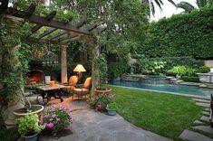 Tropical Mediterranean Backyard Garden Landscape - A Mediterranean garden design is characterized by stone structures and an arbor. But in this design, it incorporates a tropical plant selection. You'll love this backyard design with a swimming pond for a refreshing retreat.