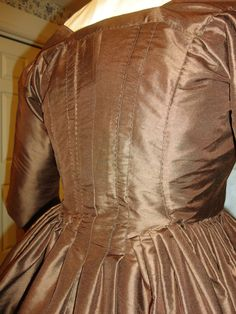 """Phebe Massey"" silk dress c.1770      Made, like the original, in chestnut brown silk. Entirely hand sewn, with a slight exception; after cutting the silk, I machine-overcast the edges of the six 22"" wide panels that make the dress & skirt, (as the original had) so that the fabric wouldn't fray during handling and making up."
