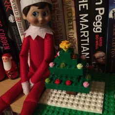 2015 - Day 7: We put our Christmas tree up yesterday so Loki decided to make himself a mini Lego tree #OurElfOnTheShelf #ElfOnTheShelf #LegoChristmasTree